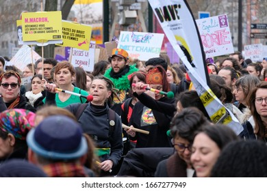 PARIS, FRANCE - MARCH 8, 2020 : Demonstration on International Women's Day. Women playing drums or waving placards to celebrate and protest against violence.