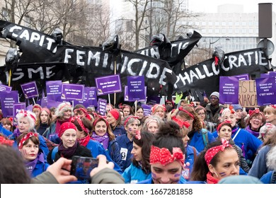 PARIS, FRANCE - MARCH 8, 2020 : Demonstration on International Women's Day. Large group of women waving placards about femicide and phalocracy