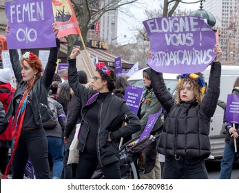 PARIS, FRANCE - MARCH 8, 2020 : Demonstration for International Women's Day. Femen waving placards to protest against patriarchy.