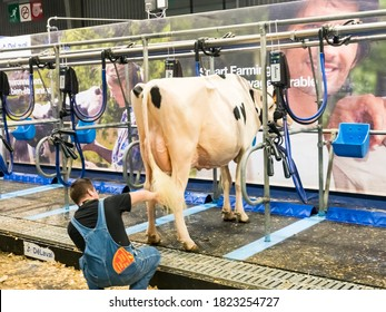 PARIS, FRANCE - MARCH Circa, 2020. Milking parlour robotics at the International Agriculture Meeting at Paris, France. to milk cows before or after competition. Modernisation of agriculture farmers