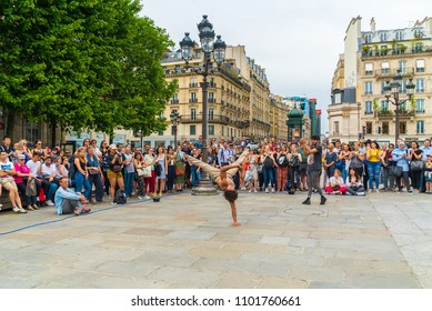 Paris, France- May 01, 2018: street artists modern dancers make performing in the street of champs elysees, france. Urban lifestyle. Hip-hop generation.