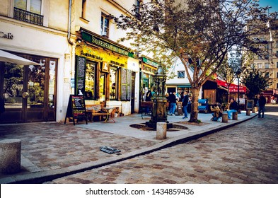 Paris, France - May 08, 2017: Paris Shakespeare And Company, people read a book outside the famous Shakespeare And Company bookshop in the Left Bank of Paris, France