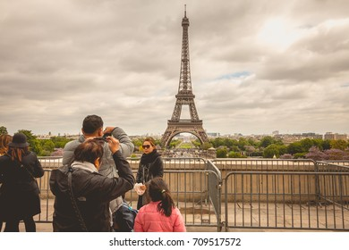 PARIS, FRANCE - May 08, 2017 : from the Place du Trocadero, tourists watch and photograph the Eiffel Tower