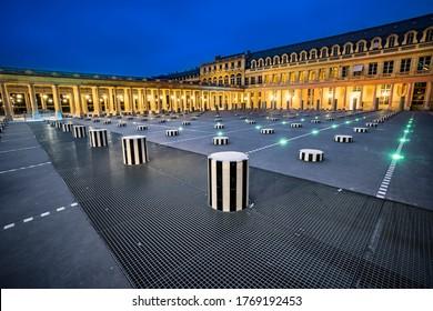 Paris, France - May 08, 2019: Panoramic view of Palais-Royal (1639) at gold hour twilight, originally called Palais-Cardinal, it was personal residence of Cardinal Richelieu in Paris. Columns Buren (1