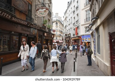 Paris, France - May 09, 2009. Visitors outside Rue Saint Severin in Little Athens, the Latin Quarter. The district of Paris is famous for its Greek restuarants and baroque crooked streets