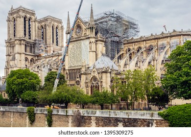 PARIS, FRANCE - MAY 09, 2019. Notre Dame de Paris, phase of verification and consolidation of the walls. A giant crane is deployed along a facade of Notre-Dame, to deposit materials on the roof.