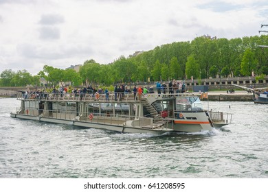 Paris, France - May 1, 2017: Tourists are cruising on the Seine river.