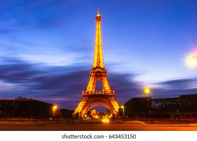 Paris, France - May 1, 2017: Long Exposure view of Eiffel tower, view from Champ de Mars in the twilight with a blue sky in a background on May 1, 2017, in Paris, France.
