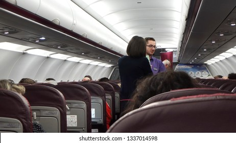 Paris, France - May 10, 2017: The steward and stewardess are serving passengers on board