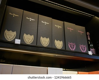 PARIS, FRANCE - MAY 10, 2018: Multiple gift boxes of Dom Perignon luxury vintage Champagne at a duty free retail store, Charles de Gaulle International Airport. Travel and shopping.