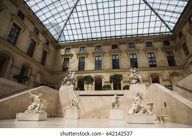 PARIS, FRANCE - MAY 11, 2014: Louvre in Paris, the largest museum in the world. Louvre Pyramid. Travel through Europe. Attractions in France.