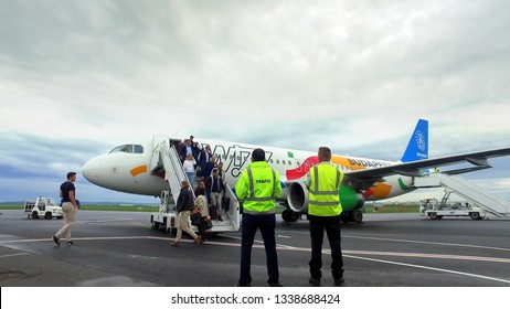 Paris, France - May 11, 2017: Passengers step off Easyjet Airplane using stairs at arrival to Paris airport