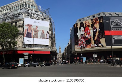 Paris, France - May 11, 2018: Large billboards and traffic on Rue la Fayette street in Paris, France on May 11, 2018