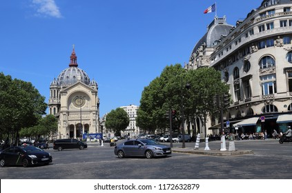 Paris, France - May 11, 2018: Traffic of cars and church on Place Saint-Augustin square in Paris, France on May 11, 2018
