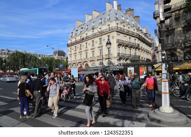 Paris, France - May 11, 2018: People cross the road on Boulevard Saint-Michel in Paris, France on May 11, 2018