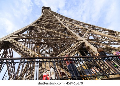 PARIS, FRANCE - MAY 12, 2015: This is view of the top of the Eiffel Tower from the bottom tier of the second floor observation deck.