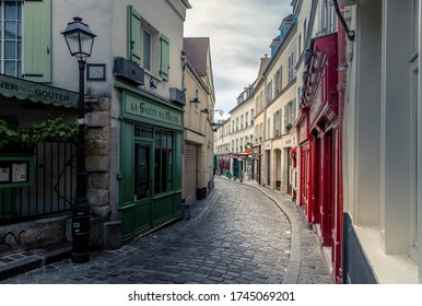 Paris, France - May 12, 2020: Typical street in Montmartre in Paris at the end of the day during lockdown due to covid-19