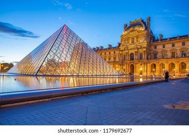 Paris, France - May 13, 2014: Pyramid Glass with view of Louvre Museum at night in Paris.