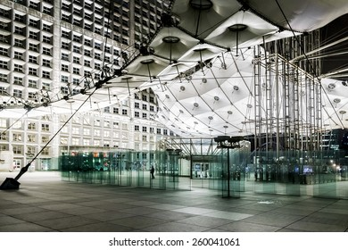 """PARIS, FRANCE - MAY 13, 2014: Grand Arch (""""Grande Arche de la Defense"""", 1989) at night - a monument in business district of Defense. Arch is a monument to humanity and humanitarian ideals."""
