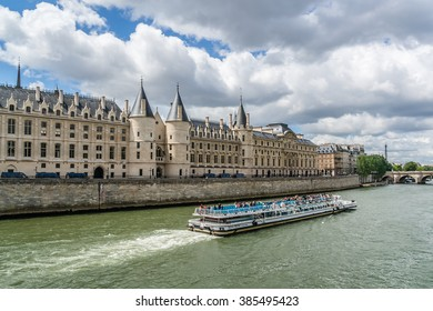 PARIS, FRANCE - MAY 13, 2014: View of the Seine River with cruise tour boats and castle Conciergerie - former royal palace and prison. Conciergerie located on the west of the Cite Island.
