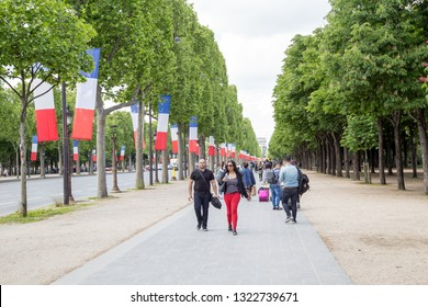 Paris, France - May 13, 2017: People walking on the famous Avenue de Champs-Elysees.