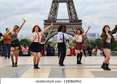 Paris, France - May 13, 2018: Girls of different ethnicity perform a dance in front of the Eiffel tower in Paris, France on May 13, 2018