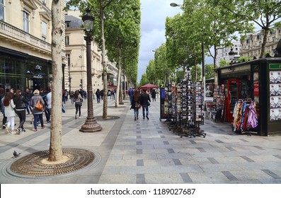 Paris, France - May 13, 2018: People walk on the Avenue des Champs-Elysees in Paris, France on May 13, 2018