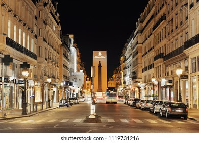PARIS, FRANCE - MAY 13: City street view at night on May 13, 2015. With the population of 2M, Paris is the capital and most-populous city of France.