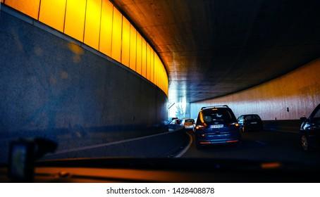 Paris, France - May 14, 2014: Driver POV point of view personal perspective at the traffic jam front driving Ford French cars inside the tunnels of Paris Peripherique ring road