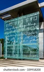 PARIS, FRANCE - MAY 14, 2014: Mur de la Paix (Wall for Peace). Mur de la Paix was erected in 2000 on Champ de Mars to symbolize passage into 3rd millennium (word PEACE is written in 32 languages).