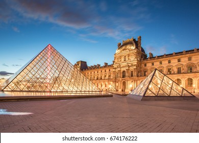 Paris, France - May 14, 2014: Louvre Museum and the Pyramid at twilight in Paris, France.