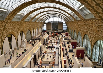 Paris, France - May 14, 2015: Visitors in the Musee d'Orsay in Paris, France. on May 14, 2015, The museum houses the largest collection of impressionist and post-impressionist masterpieces.