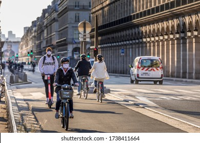 Paris, France - May 14, 2020: Young man on his bike with a surgical mask to protect himself from covid-19 in a street in Paris