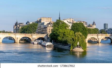 Paris, France - May 14, 2020: View of Pont neuf bridge, oldest bridge in Paris and Conciergerie in background