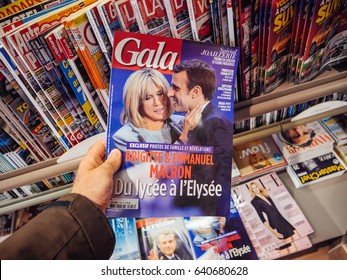 PARIS, FRANCE - MAY 15, 2017: Man buys Gala magazine Emmanuel Macron and his wife Brigitte Trogneux during handover ceremony presidential inauguration newly elected French President Emmanuel Macron