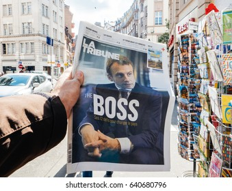 "PARIS, FRANCE - MAY 15, 2017: Emmanuel Macron ""The Boss"" title on La Tribune newspaper reporting handover ceremony presidential inauguration of the newly elected French President Emmanuel Macron"