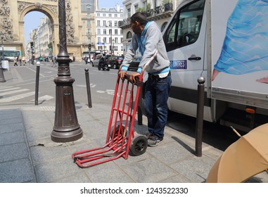 Paris, France - May 15, 2018: Migrant day laborer waiting for a job in Rue Saint-Denis street in Paris, France on May 15, 2018