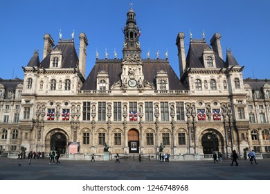 Paris, France - May 15, 2018: People walk in front of the Hotel de Ville, the old city hall of Paris, France on May 15, 2018