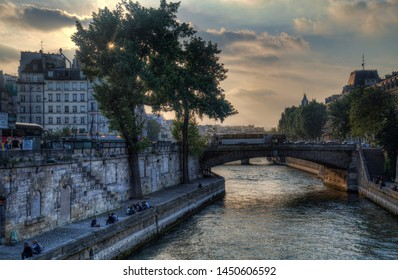 Paris, France - May 15, 2018: Sunset on the Seine river near Notre Dame in Paris, France on May 15, 2018
