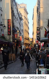 Paris, France - May 15, 2018: Tourists walk past the hotels and restaurants in Rue de la Huchette in the evening in Paris, France on May 15, 2018