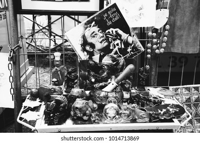 PARIS, FRANCE - MAY 16, 2016: Flea market typical kitsch. Vinyl record with Salvador Dali interviews and collection of funny ceramic frogs for sale. Shopping at flea market is popular French hobby.