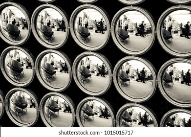 PARIS, FRANCE - MAY 16, 2016: Flea market in Paris. Shoppers and stalls reflected in old mirrors construction. Abstract conceptual. Black and white photo.