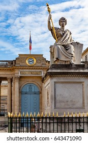 Paris, France - May, 16, 2017 : View of French National Assembly ( Palais Bourbon ) with statue Law in foreground.
