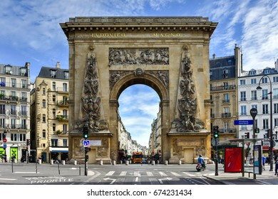 Paris, France - May 16, 2017: The Porte Saint-Denis, built in 1672, designed by architect Francois Blondel at the order of Louis XIV in Paris, France.