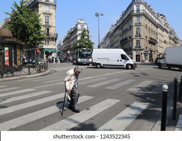 Paris, France - May 16, 2018: Old lady crossing the road on Rue de Saint-Pétersbourg street in Montmartre in Paris, France on May 16, 2018