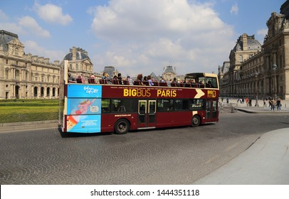 Paris, France - May 16, 2018: Double decker with tourists drives past the Louvre museum in Paris, France on May 16, 2018