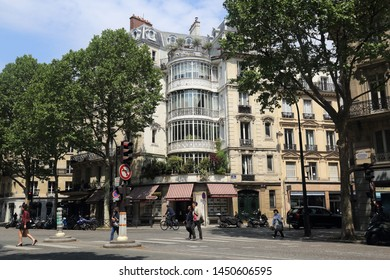 Paris, France - May 16, 2018: People cross the street on Rue de Malesherbes in Paris, France on May 16, 2018