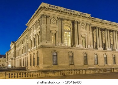 PARIS, FRANCE - MAY 17, 2014: Night view of Louvre building in Louvre Museum. With 8.8 million annual visitors, Louvre is consistently the most visited museum worldwide.