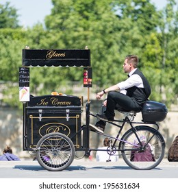 PARIS, FRANCE - MAY 17, 2014: Ice cream seller with bicycle on the street.