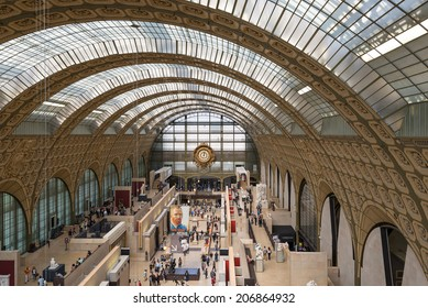 PARIS, FRANCE - MAY 17, 2014: Visitors in the Musee d'Orsay. Opened in 1986, it houses the largest collection of impressionist and post-impressionist masterpieces in the world.